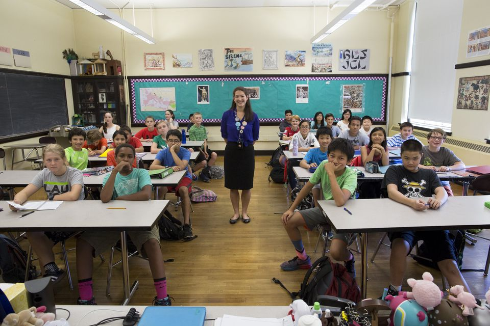 Teacher Elizabeth Moguel poses for a photograph with her seventh grade Latin class at Boston Latin School in September.