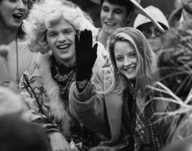2/11/1992.. Hasty Pudding - Jodie Foster waves to the crowd before being named woman of the year by the Hasty Pudding Club. At left is Hasty Pudding vice president, Bart St. Clair. (14hasty) 18HastyPudding