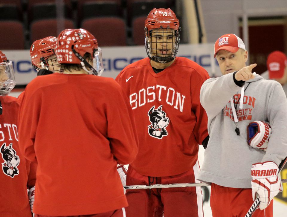 Jordan Greenway takes direction from BU assistant coach Scott Young during a recent practice.