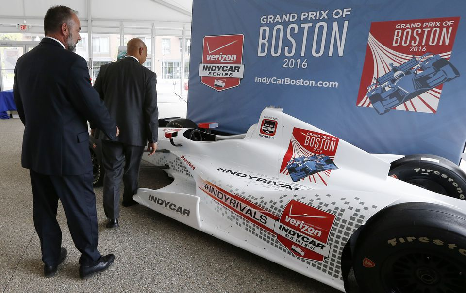 City officials examined an IndyCar mockup last year.