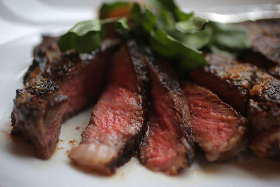 100-day-aged ribeye. A new study finds that eating red meat can raise the levels of a compound called TMAO in your blood.