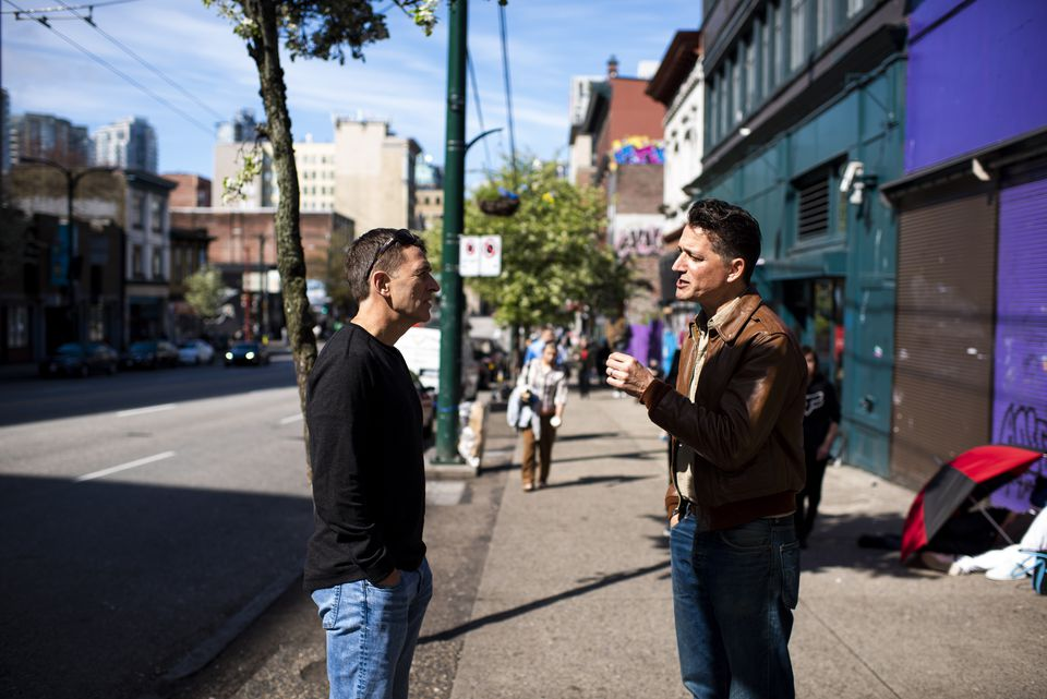 Dr. Mark Tyndall (right) spoke with Darwin Fisher, a program manager at Insite, in front of the safe-injection site.