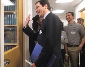 French Consul General Fabien Fieschi waved to a class during a tour of Codman Academy in Dorchester on Wednesday.