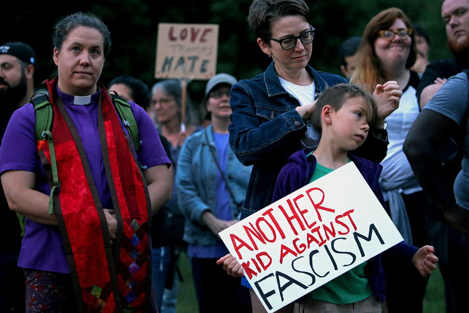 Sarah Kanouse of Jamaica Plain and her daughter Genesee Brown, 8, were among about 300 who gathered for a rally on Boston Common Saturday in reaction to violence in Charlottesville.