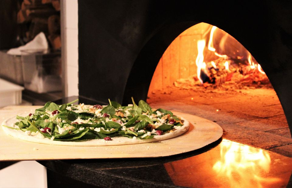The West Coast (with fig jam and prosciutto) is baked in a wood-fired oven.