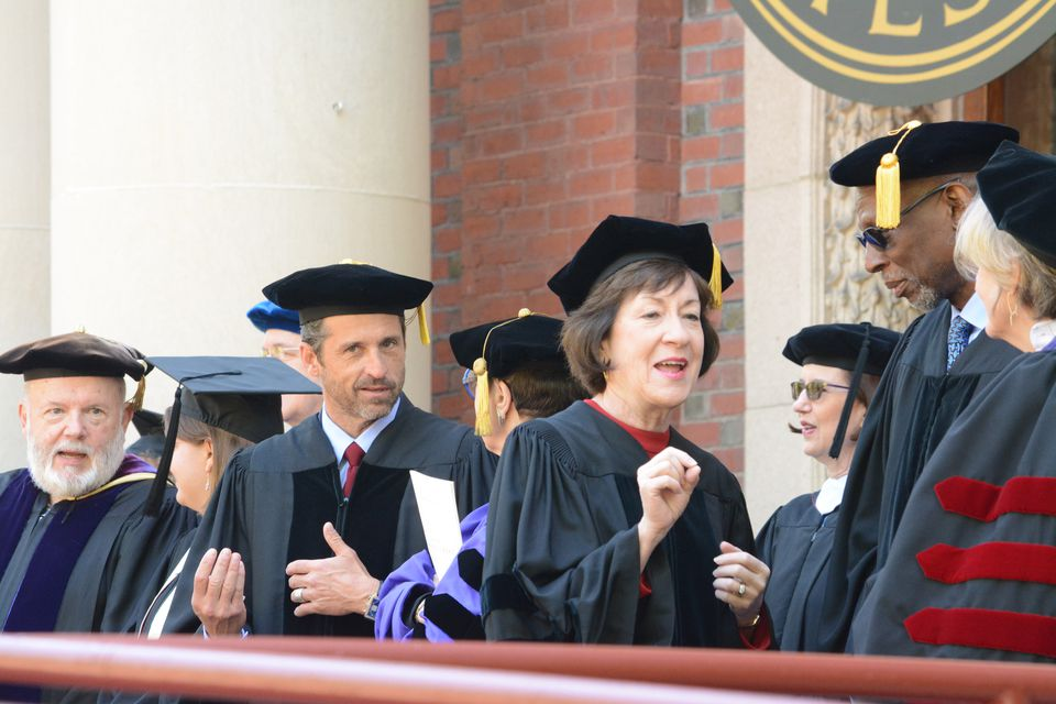 Actor Patrick Dempsey (fourth from left) snuck a peek at the camera while US Senator Susan Collins of Maine (fourth from right) chatted before the Bates College commencement Sunday.