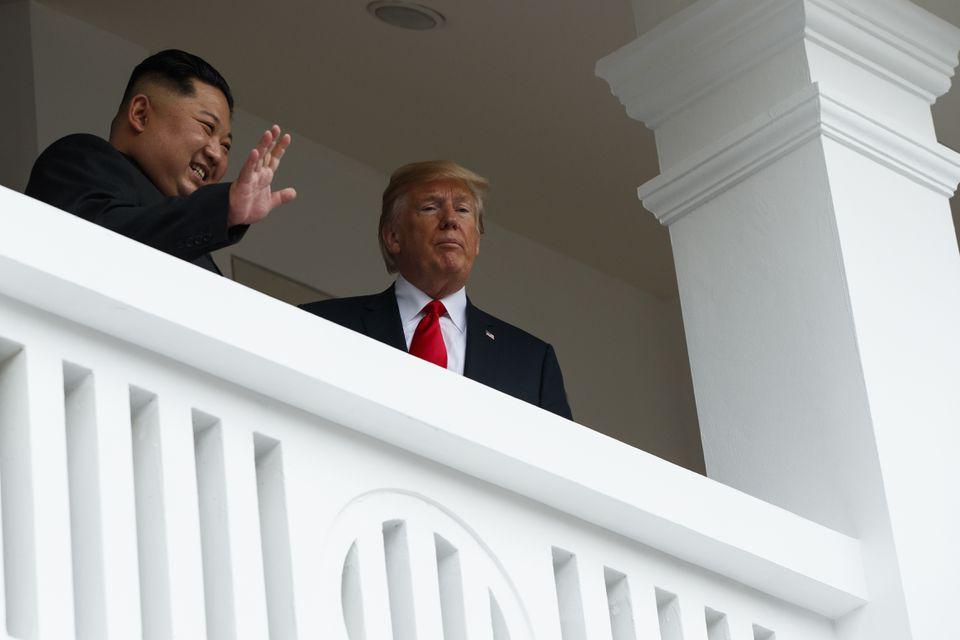 Kim waved while Trump stared out at the masses from a balcony.