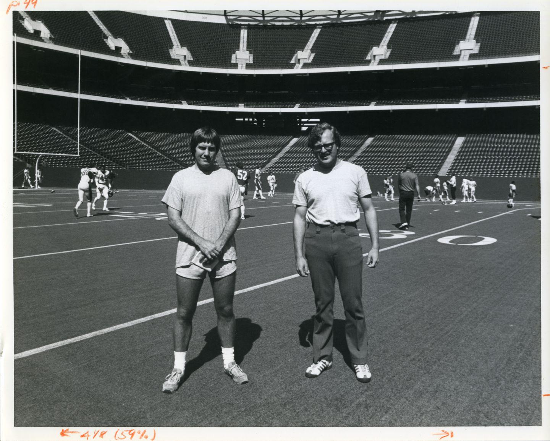 Bill Belichick (left) and Ernie Adams (right).