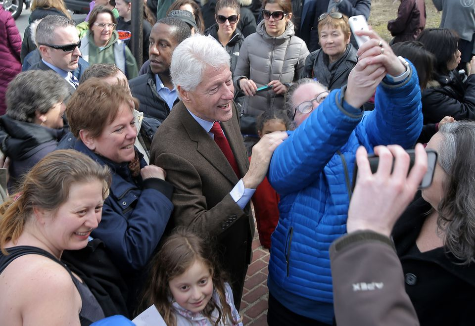 Bill Clinton posed with supporters in Newton.