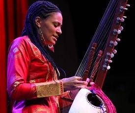 Sona Jobarteh (left) and her band will play the Somerville Theatre Oct. 11 and Women of the World (right) will perform in Natick Sept. 14.