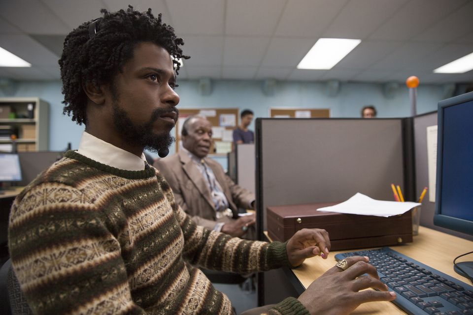 "Lakeith Stanfield (left) and Danny Glover (background) in ""Sorry to Bother You."""