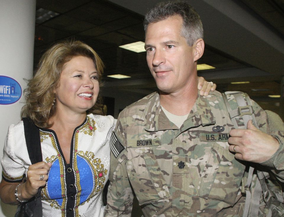 Senator Scott Brown greeted his wife, Gail Huff, after returning from his military tour in Afghanistan last year.