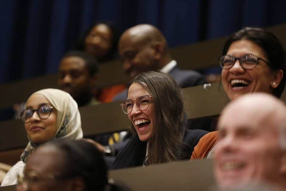 Fellow congresswomen-elect Alexandria Ocasio-Cortez, center, and Rashida Tlaib, right, laughed as city councilors referenced them in their farewell speech to Ayanna Pressley at City Hall.