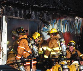 Firefighters in search of victims at the entrance to the Station nightclub in West Warwick, R.I., in early Feb. 21, 2003.