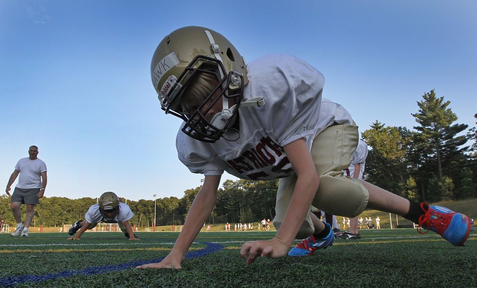 Young football players practice drills in Concord in August.