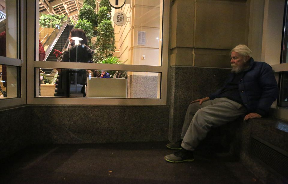 Mike, 65, who said he has been homeless for five years, found a spot just inside the Prudential, near the Green Line, to stay warm Sunday night.