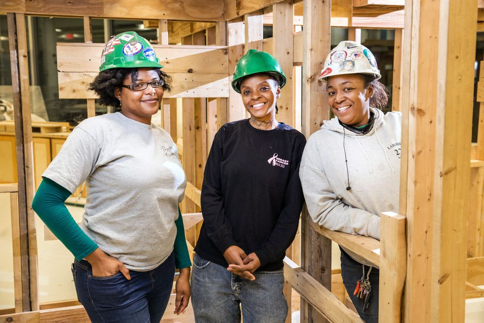 Women like (from left) Shamaiah Turner, Shara Noldseiro, and Jenaya Pina-Nelson have a brighter future, thanks to efforts to move females into well-paying construction trades.