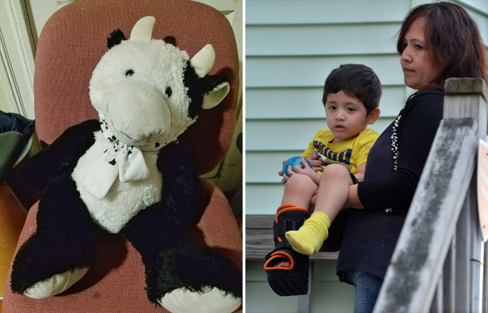Luis Eduardo Gomez, of Chelsea, was carried home from the hospital by his mother after the boy fell out of a second-story window, landing on his stuffed animal (at left).