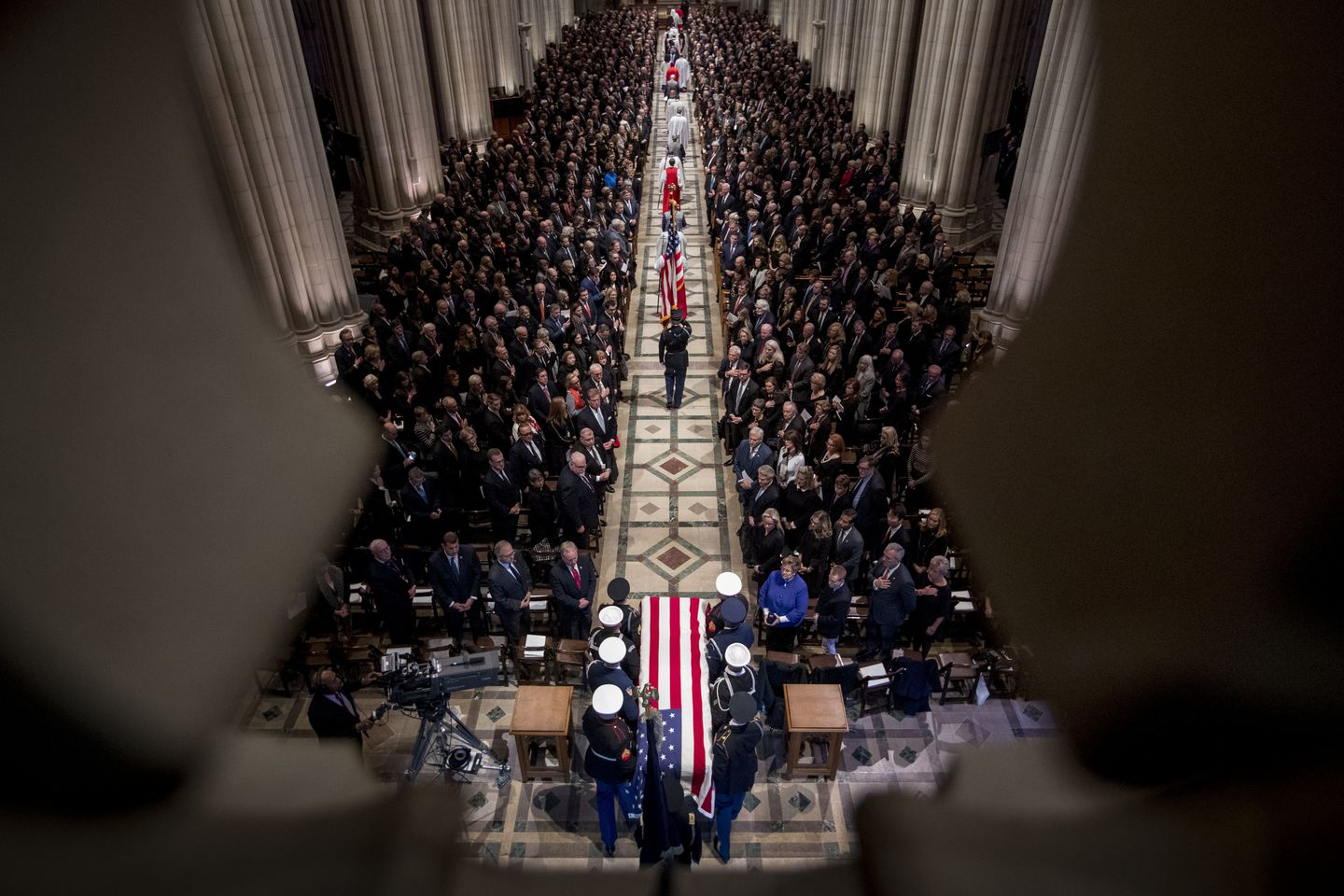 The flag-draped casket of former President George H.W. Bush was carried by a military honor guard.