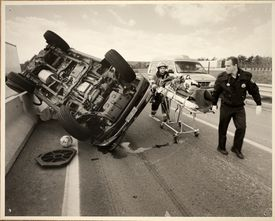A photo in Rick Stack's collection shows him (right) at the scene of a car crash. Captain Rick Stack, a long-time North Attleboro firefighter, has been diagnosed with PTSD.