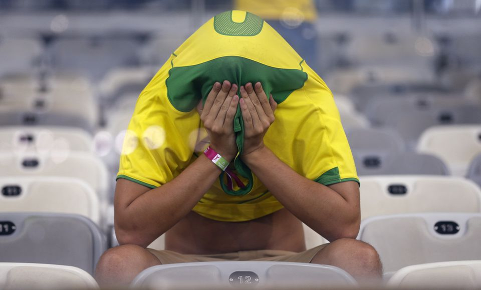 A Brazil fan covers his face after Germany's 7-1 victory in their World Cup semifinal.