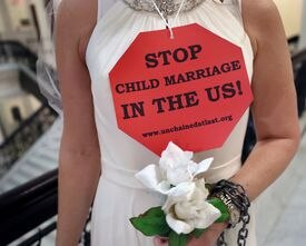 Protesters in bridal gowns at the State House in Boston called for the end of child marriage last month.