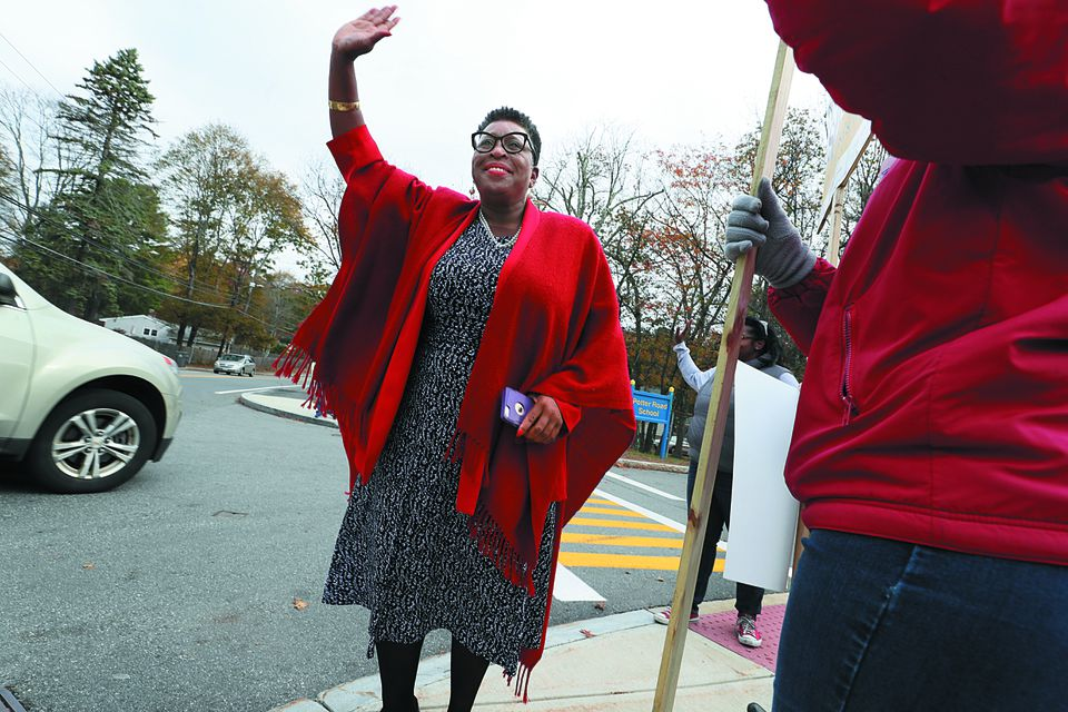 Yvonne Spicer was elected to be the first mayor in Framingham's history. The town's transition to a city will culminate on Jan. 1, when Spicer will be sworn in. Above: Spicer waved to supporters on election day.