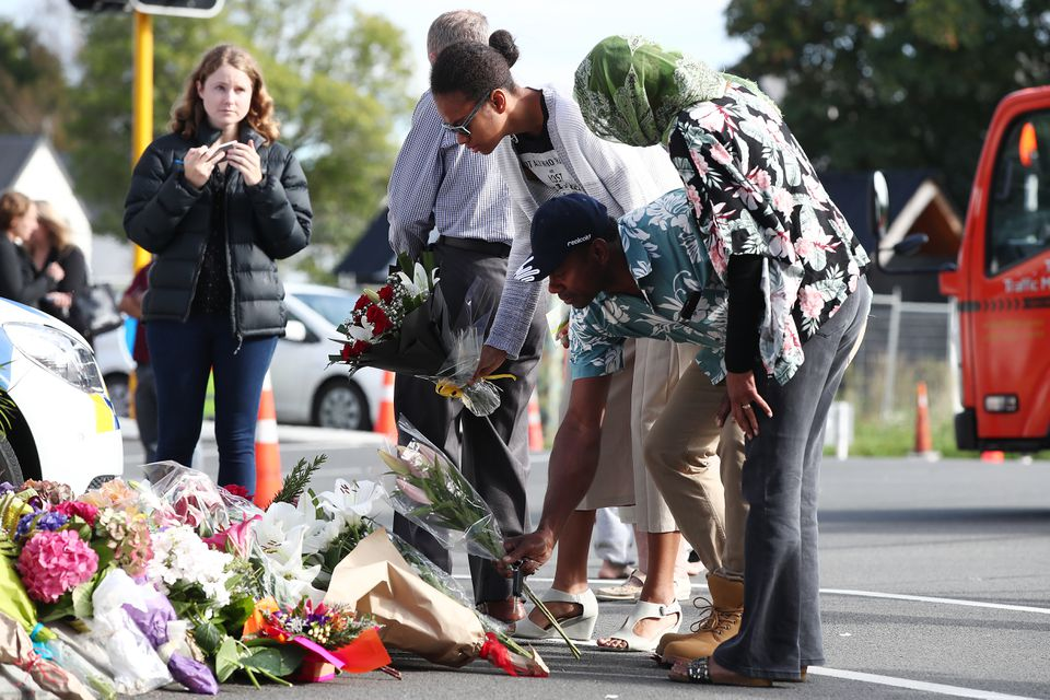 Mourners paid their respects Saturday at a makeshift memorial in Christchurch, New Zealand, near one of the mosques attacked on Friday.