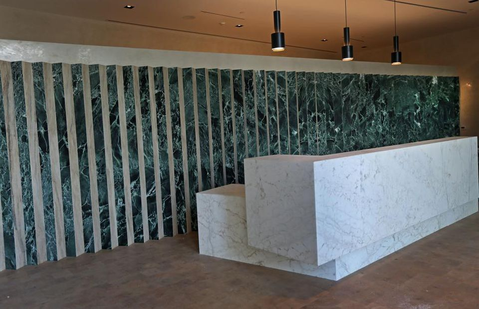 A marble and travertine wall is a focal point of the two-story atrium, where 24-hour concierge service and meeting areas are available. The Viridian is pet-friendly.