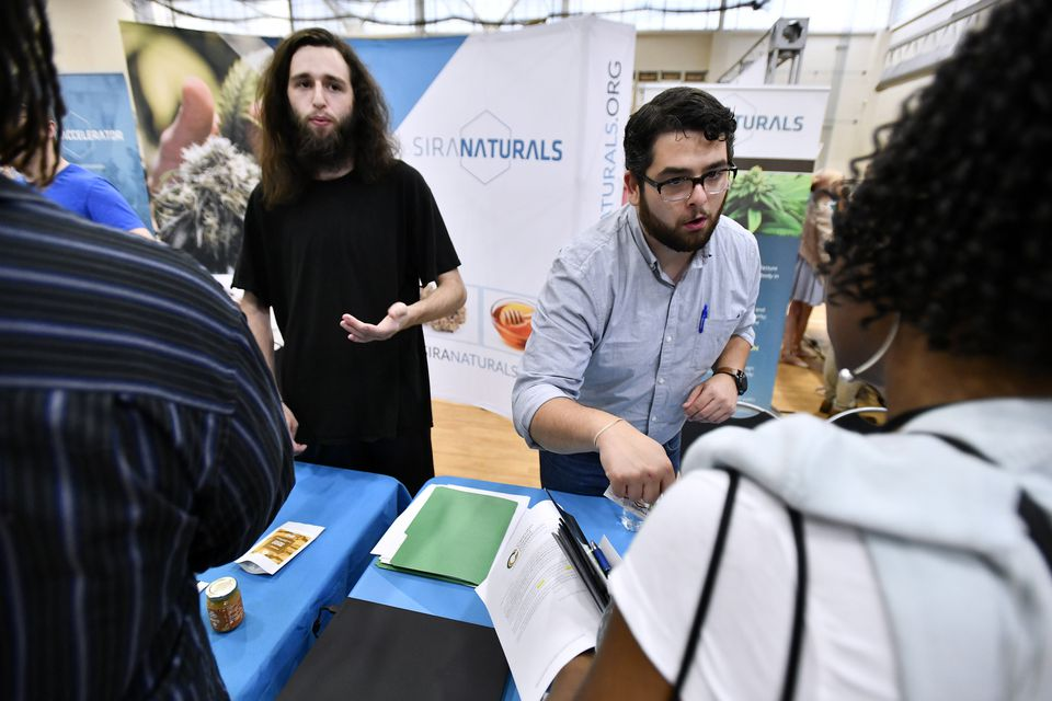 Aaron Wang and Nic DiBella of local marijuana producer Siri Naturals spoke with prospective employees.