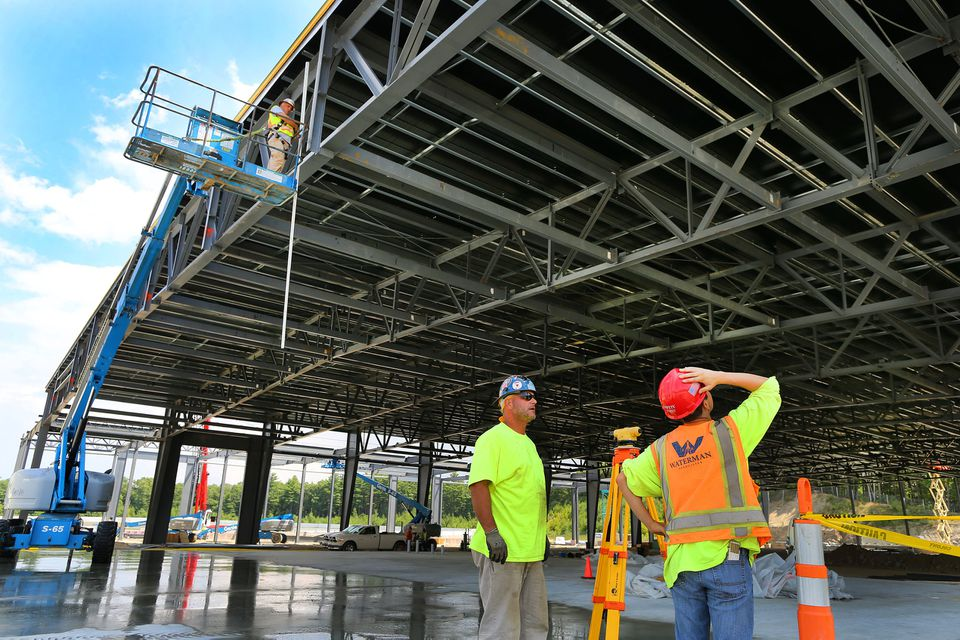Work continues on the Plainridge racecourse slot parlor, as the steel frame of the prefab slots building is constructed.