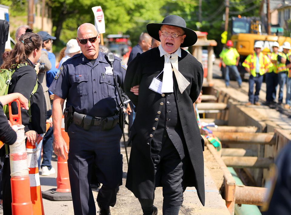 Over a dozen clergy were arrested, including Rev. John Gibbons from The First Parish in Bedford, at the West Roxbury Lateral Pipeline construction site on Grove Street.