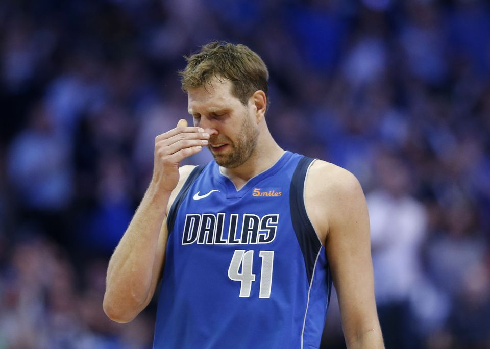 527cd08c1 Dallas Mavericks forward Dirk Nowitzki gets emotional after a video played  during a break in the