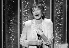Actress Shirley MacLaine accepted her Oscar, 1984.