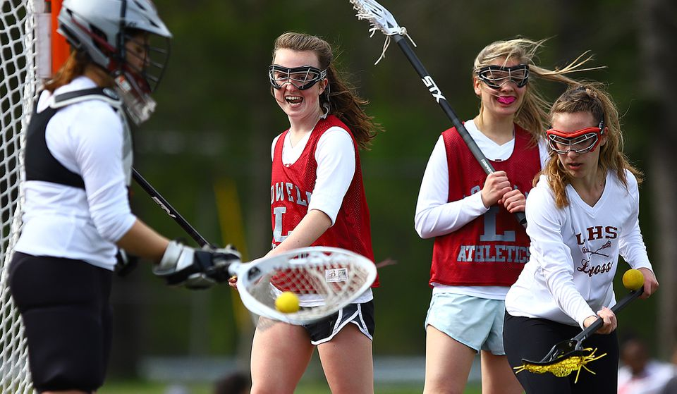 """As far as she's concerned, senior captain Hannah Erickson (center) knows why Lowell is 11-3, on a six-game winning streak, and poised to be one of the school's best girl's lacrosse teams. """"We're working more as a team because we have more skilled players, all around,"""" she said."""