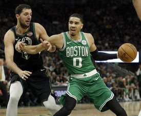 The Celtics' Jayson Tatum (0) tried to hold off the Bucks' Nikola Mirotic in the second half.