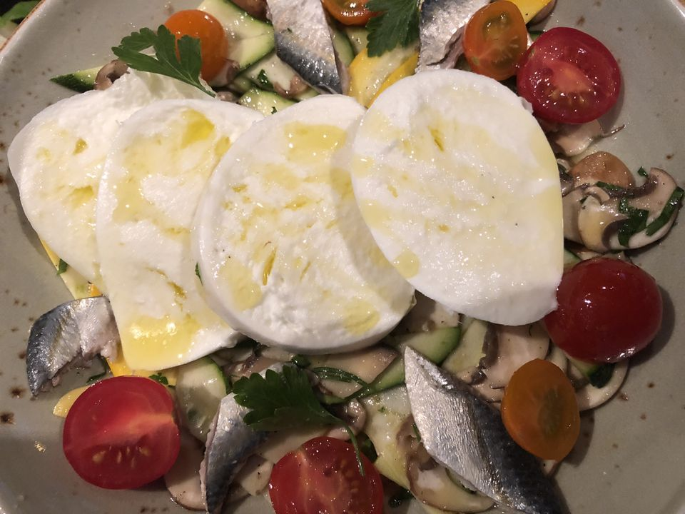 Zucchini, shaved mushroom, and tomato salad with buffalo mozzarella and anchovy