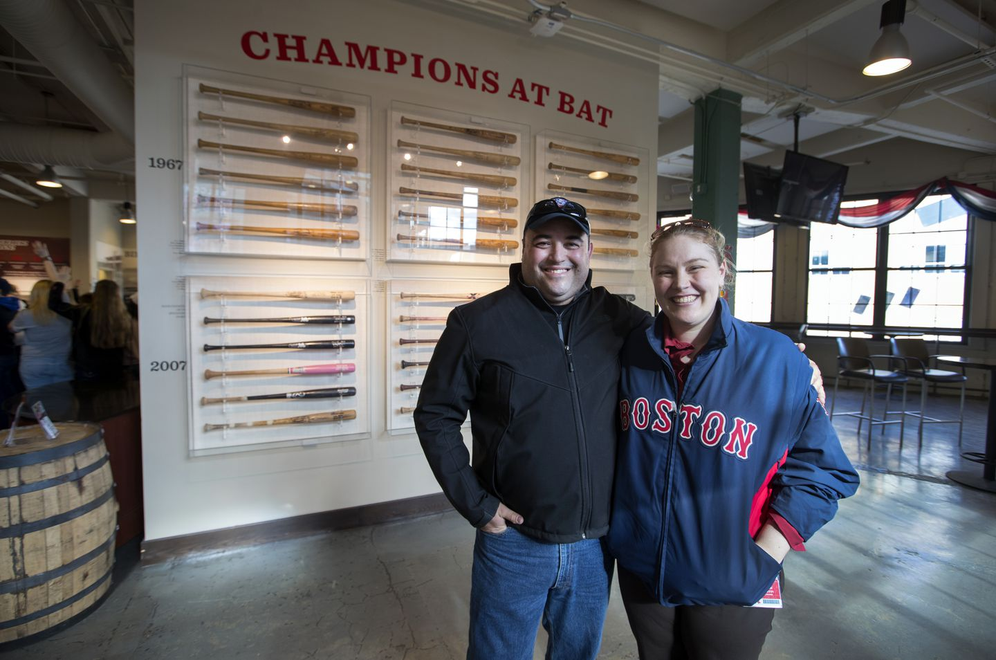 Red Sox curator Sarah Coffin (right) borrowed some of the bats for a display in the Royal Rooters Club.