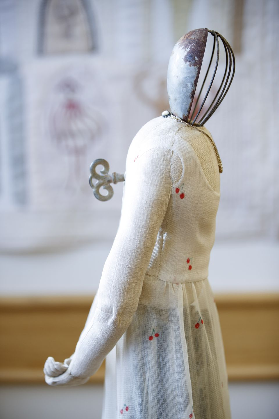 """This work by Lorraine Sullivan is titled """"Mother in Her Cherry Dress."""""""