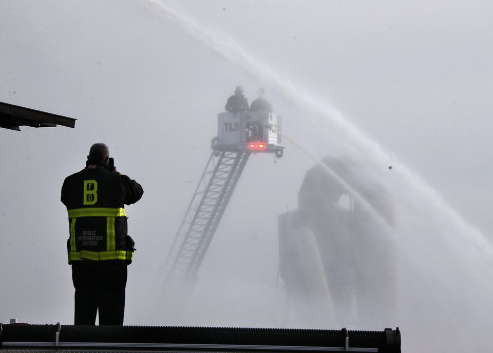Firefighters on a ladder truck did their best to attack the fire.