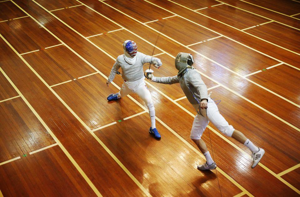 Eli Dershwitz (left) worked on his craft at Zeta Fencing in Natick.