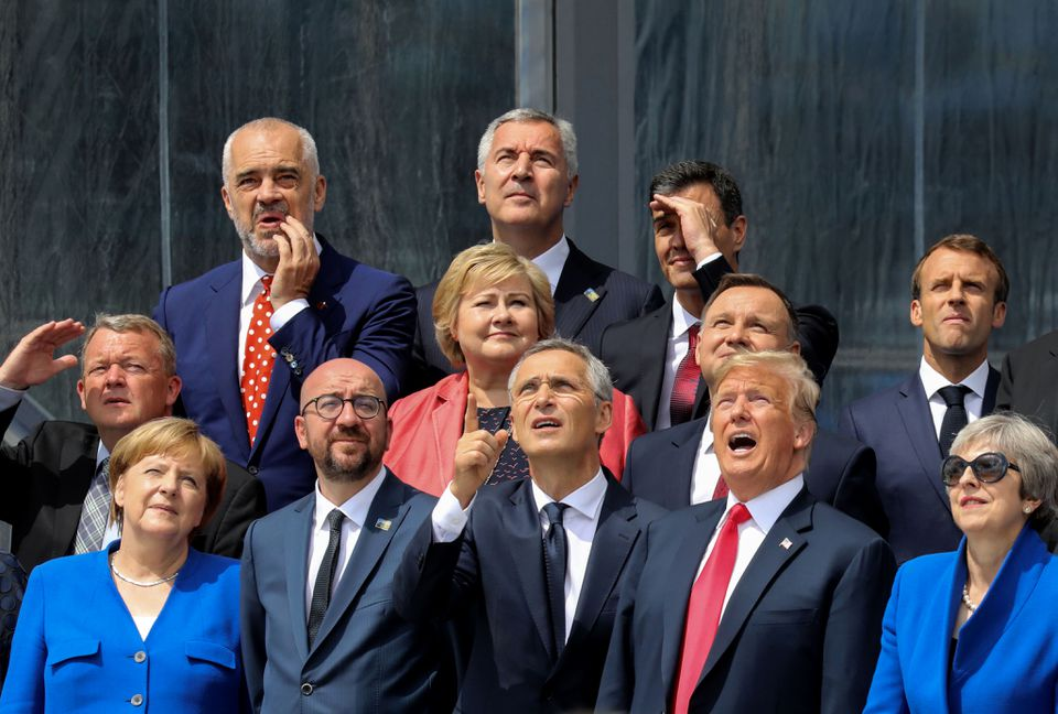 President Trump and European leaders watched a helicopter during a group photo in Brussels on Wednesday.