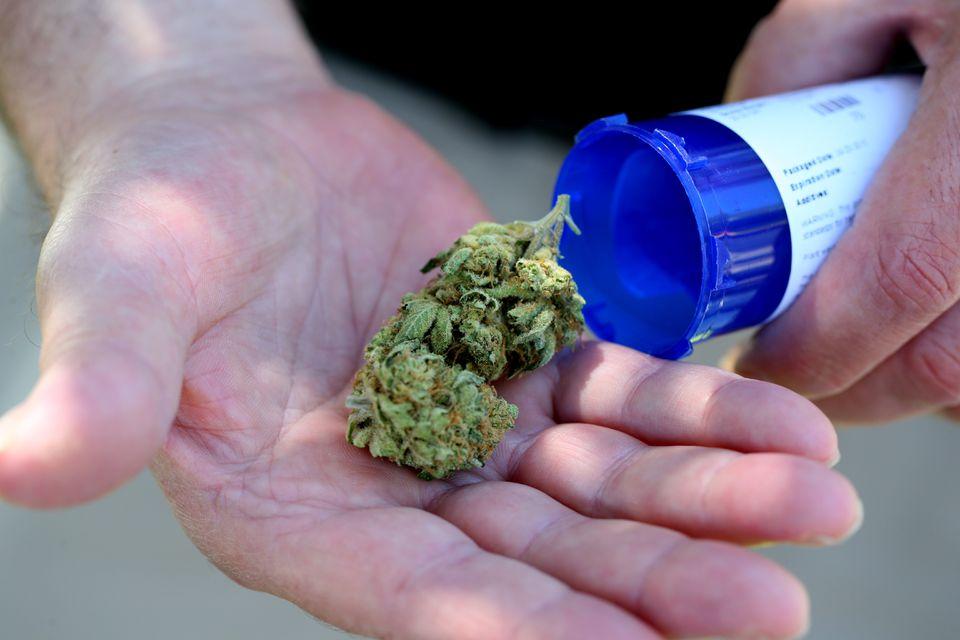 Chuck Grant displayed his medical marijuana that he picked up from Massachusetts first medical marijuana dispensary in Salem last June.