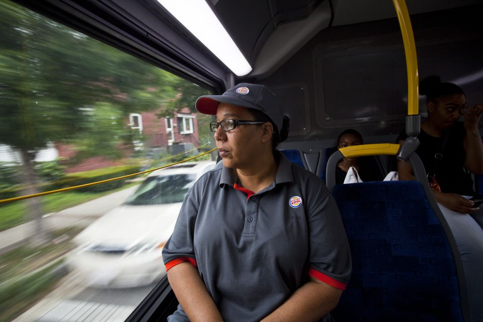 Enid Lugo, 52, on the bus this week to her fast-food job in Holyoke, says she gets no paid vacation time.