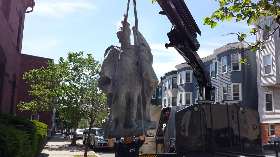 The statue of St. Florian is placed outside of Father Dan Mahoney's church in Charlestown.