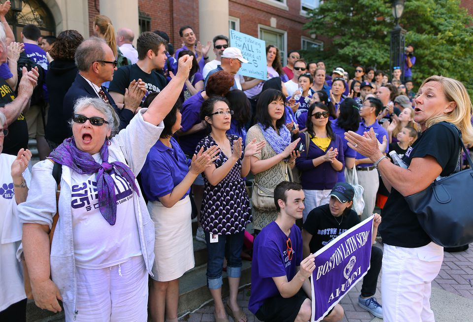Barbara Peterlin (right) rallied Boston Latin School parents and alumni outside the school on the front steps after the two recent resignations in the administration at the school.