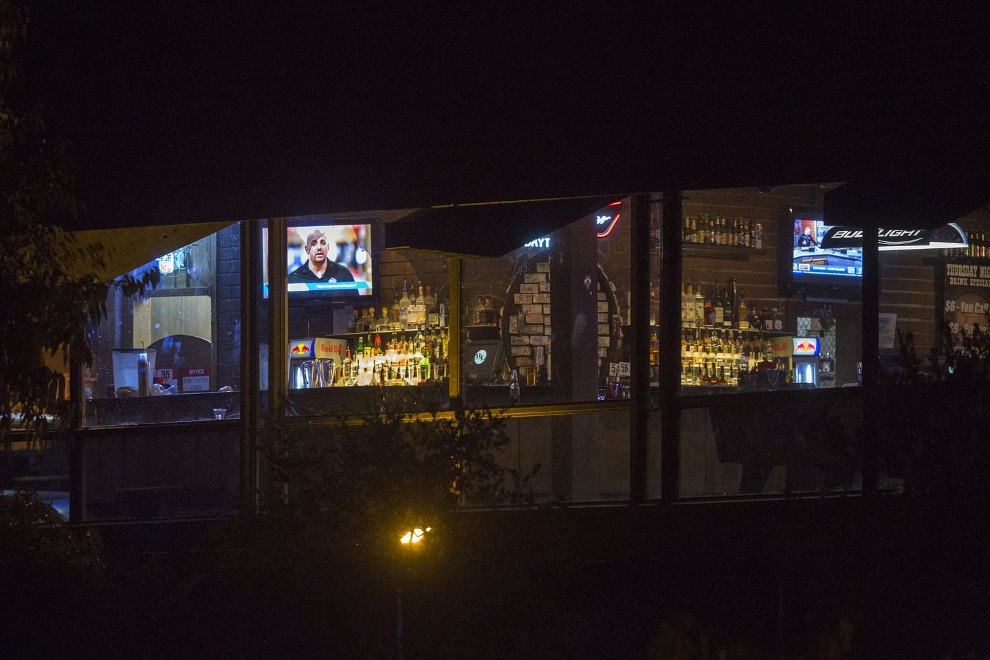 Light shone from inside The Borderline Bar and Grill, the scene of a mass shooting..