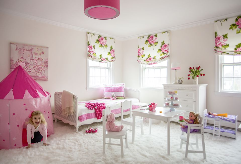 The walls in the girl's room are lightly tinted pink to complement the rest of the decor.