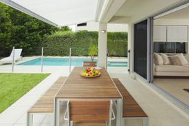 <b>COME OUTSIDE: </b>Adding a dining area increases the functionality of your backyard.