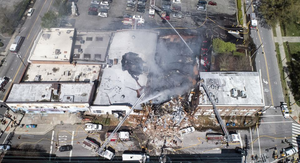 Firefighters battled a fire at the scene of an explosion in Durham, N.C.
